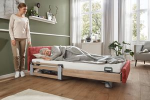 With our Vario-Safe system, here on the Elvido vervo care bed, safety sides, side panels and individually designed head and footboards can be combined and replaced without tools.