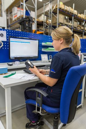 Our warehouse manager downloads a customer order to her Handheld device. The device calculates the best route through the warehouse to the spare parts.